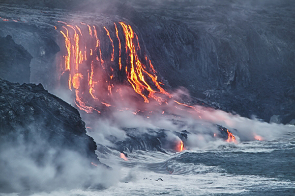 13709660 - lava erupting into pacific ocean in hawaii big island