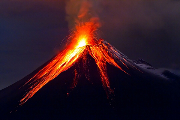 15897662 - tungurahua volcano eruption at night, with snow, ecuador